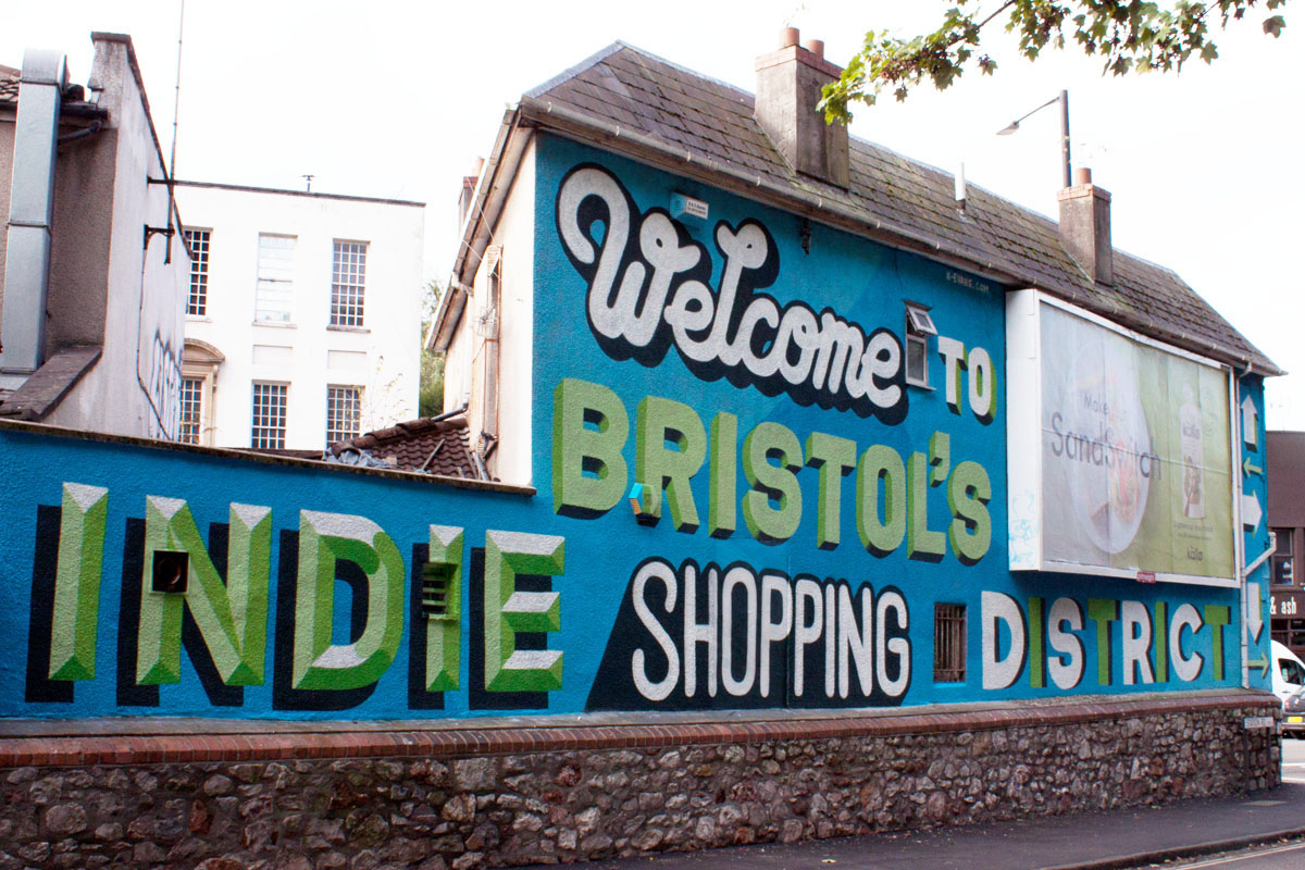 Welcome to bristols indie shopping district nathan evans huge hand painted lettering mural welcoming people to the gloucester road area of bristol reheart Image collections